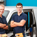 Father and son in front of family business work truck