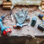 Gloves and tools on a construction job