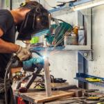 Man welding in his shop