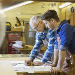 Older contractor training apprentice